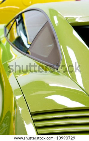 an image of a Italian sports cars in green and yellow - stock photo