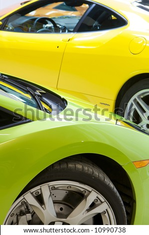 an image of a Italian sports cars in green and yellow Lamborghini and Ferrari - stock photo