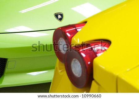 an image of a Italian sports cars in green yellow Lamborghini and Ferrari - stock photo