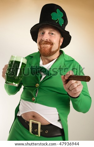 An image of a Leprechaun drinking green beer and smoking a cigar on St. Patrick's Day. - stock photo