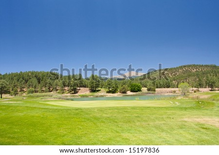 An image of a lush Arizona golf course - stock photo