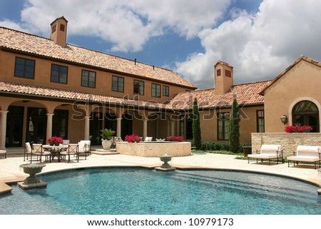 an image of a luxury home looking over the pool