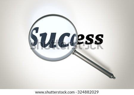 An image of a magnifying glass and the word success
