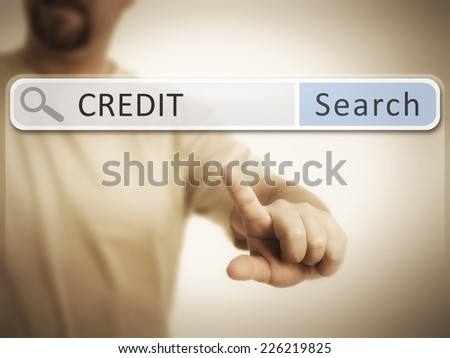 An image of a man who is searching the web after credit - stock photo