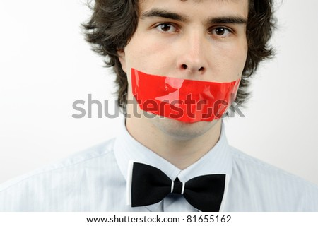 An image of a man with a tape on his mouth - stock photo