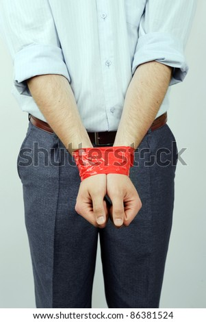 An image of a man with his hands bound - stock photo