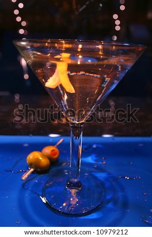 an image of a martini glass with a twist of lemon on blue wet bar - stock photo