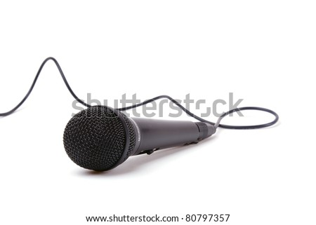 An image of a microphone isolated on white background - stock photo