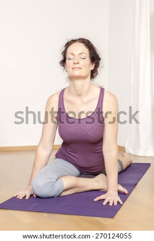 An image of a middle age woman doing yoga - stock photo