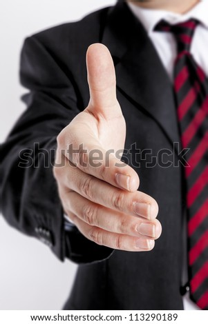 An image of a nice business handshake - stock photo