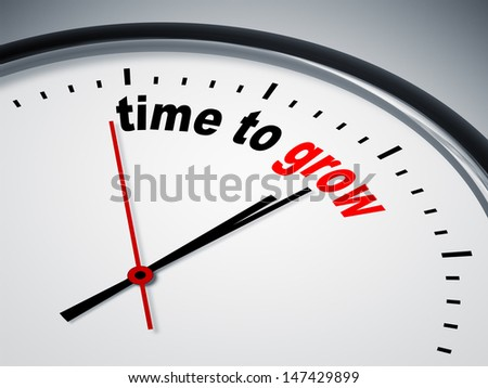 An image of a nice clock with time to grow - stock photo