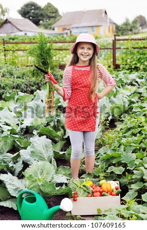 An image of a nice girl in the kitchen-garden
