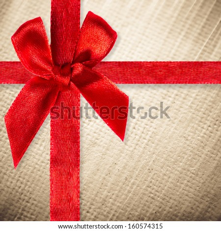 An image of a nice red ribbon on paper background for your content - stock photo
