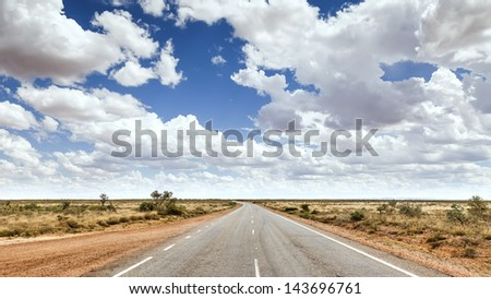 An image of a nice road to the horizon - stock photo