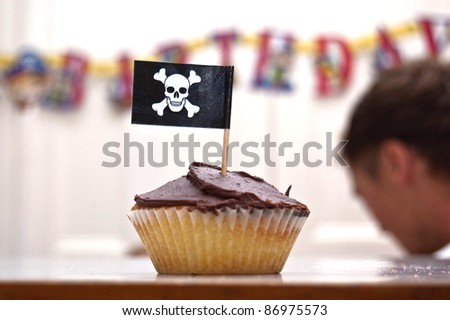 an image of a party pirate cupcake with a skull and crossbones flag.