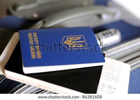An image of a passport and tickets on a valise