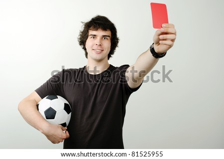 An image of a referee showing red card - stock photo
