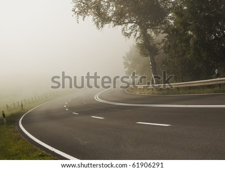 An image of a road covered in fog