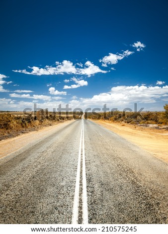 An image of a road to the horizon - stock photo