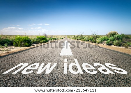 An image of a road to the horizon with text new ideas - stock photo
