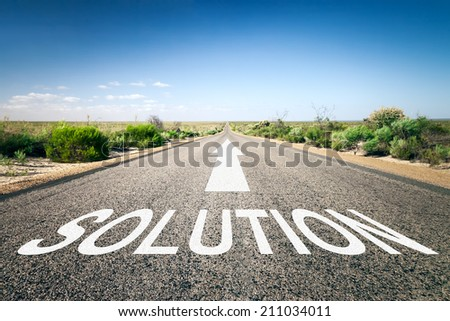 An image of a road to the horizon with text solution - stock photo