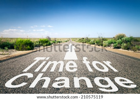 An image of a road to the horizon with text time for change - stock photo
