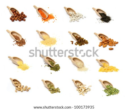An image of a set of groats and nuts in scoops - stock photo