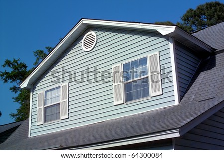 an image of a single blue house - stock photo