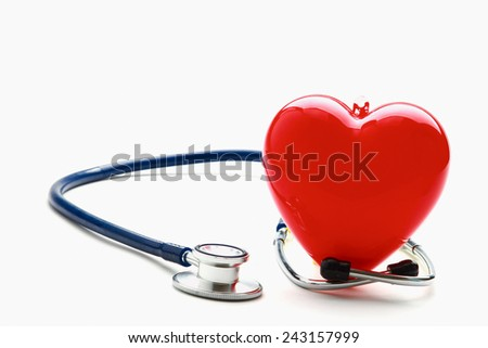 An image of a stethoscope and a red heart isolated on white background - stock photo