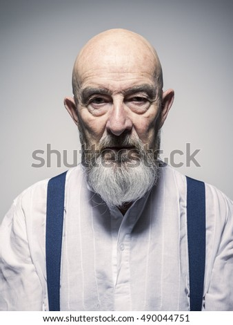 An image of a strange looking older man portrait