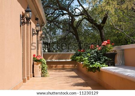 an image of a sun drenched european veranda - stock photo