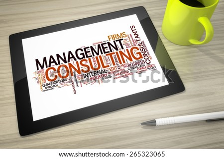 An image of a tablet pc with tag cloud management consulting - stock photo