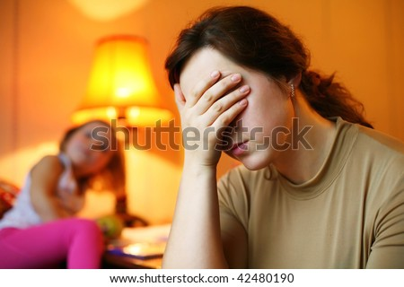 An image of a tired woman and a child - stock photo
