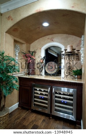 An image of a top of the line wet bar with wine chillers