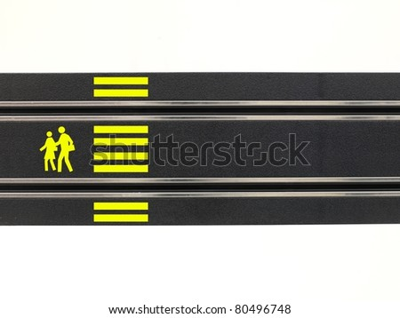 An image of a toy slot car racing track road crossing - stock photo