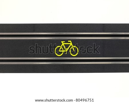 An image of a toy slot car racing track with a bicycle symbol - stock photo