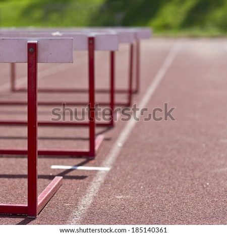 An image of a training hurdle in the sunshine. Image taken outdoor in the training field. The hurdle obstacle is a bit lower than normal. - stock photo