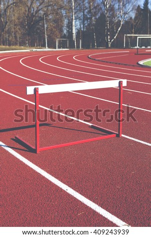 An image of a training hurdle in the sunshine. Image taken outdoor in the training field. The hurdle obstacle is a bit lower than normal. Image has a vintage effect applied. - stock photo
