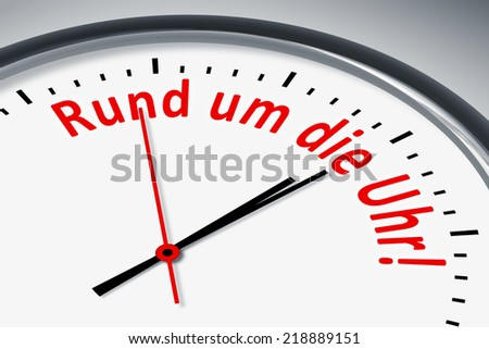 An image of a typical clock with text around the clock in german language