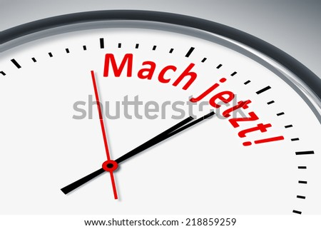 An image of a typical clock with text make now in german language