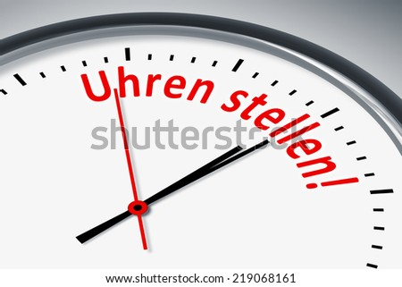 An image of a typical clock with text set clock in german language
