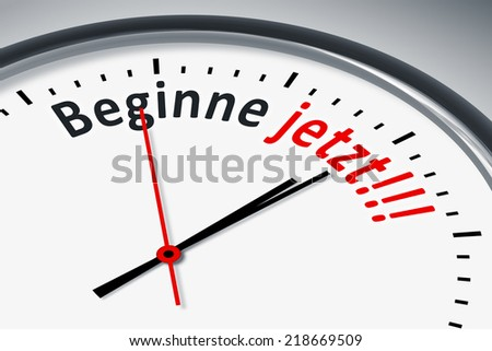 An image of a typical clock with text start now in german language