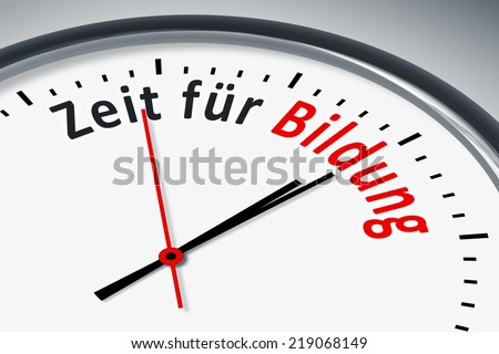 An image of a typical clock with text time for education in german language