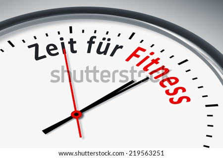 An image of a typical clock with text time for fitness in german language