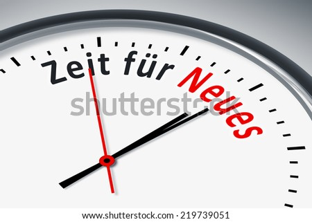An image of a typical clock with text time for new in german language