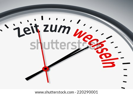 An image of a typical clock with text time to change in german language