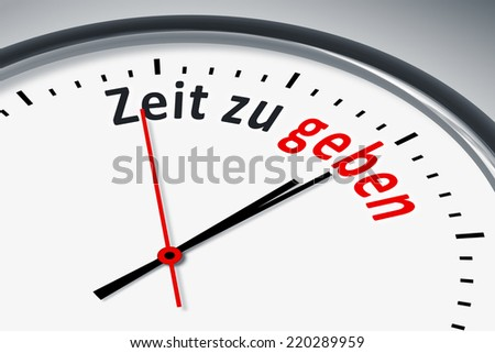 An image of a typical clock with text time to spend in german language - stock photo
