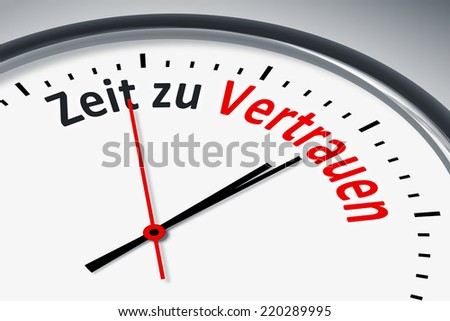 An image of a typical clock with text time to trust in german language