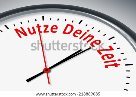 An image of a typical clock with text use your time in german language