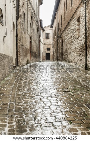 An image of a typical italian city street at rain - stock photo
